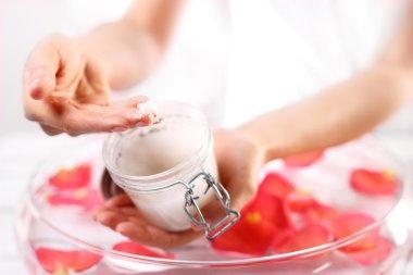Beauty salon, manicure with hands peeling