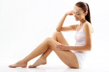 Cellulite. A woman checks the stretch marks on legs