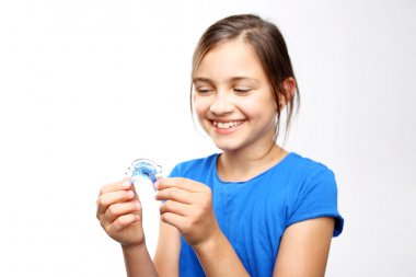 Child with orthodontic appliance.