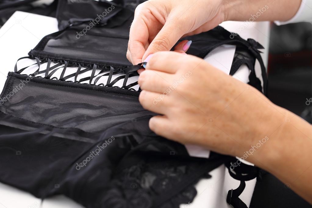 Seamstress sews underwear.