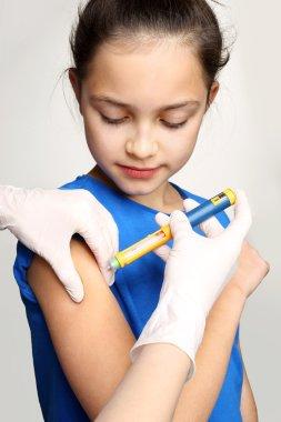 Diabetes in children, child take insulin