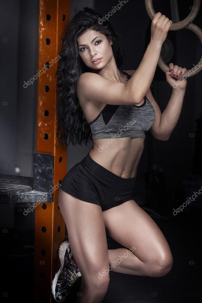 Sexy brunette woman in the gym.
