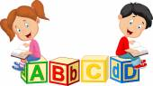 Fotografie Children cartoon reading book and sitting on alphabet blocks