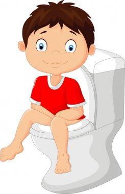 Little boy cartoon sitting on the toilet