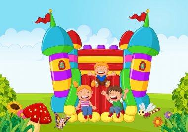 Cartoon little kid playing slide on the inflatable balloon