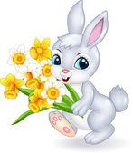 Roztomilý zajíček drží květinku