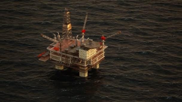 Oil Rig Drilling Platform At Sunset