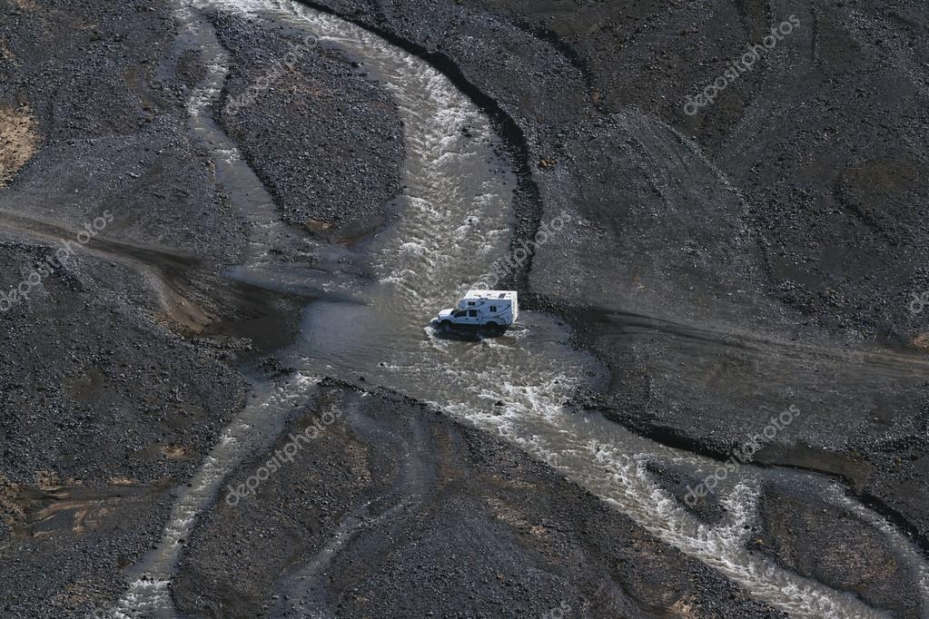 4WD car wades river in Landmannalaugar, South Iceland