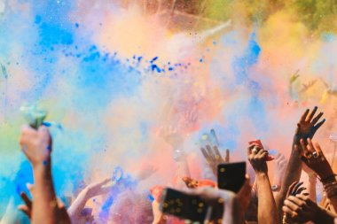 Celebrants dancing during the color Holi Festival stock vector