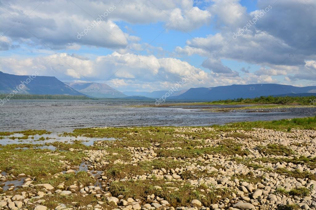 Cloudy sky over the lake in  Putorana plateau.