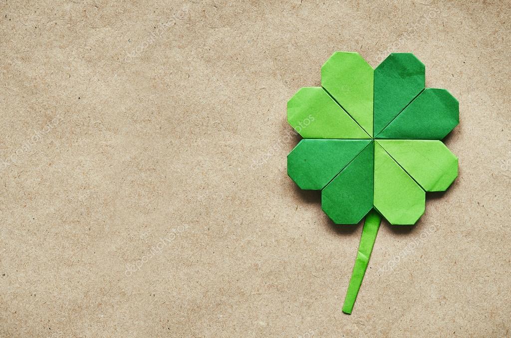 Green origami paper shamrock clover leaf on eco paper background. St ...