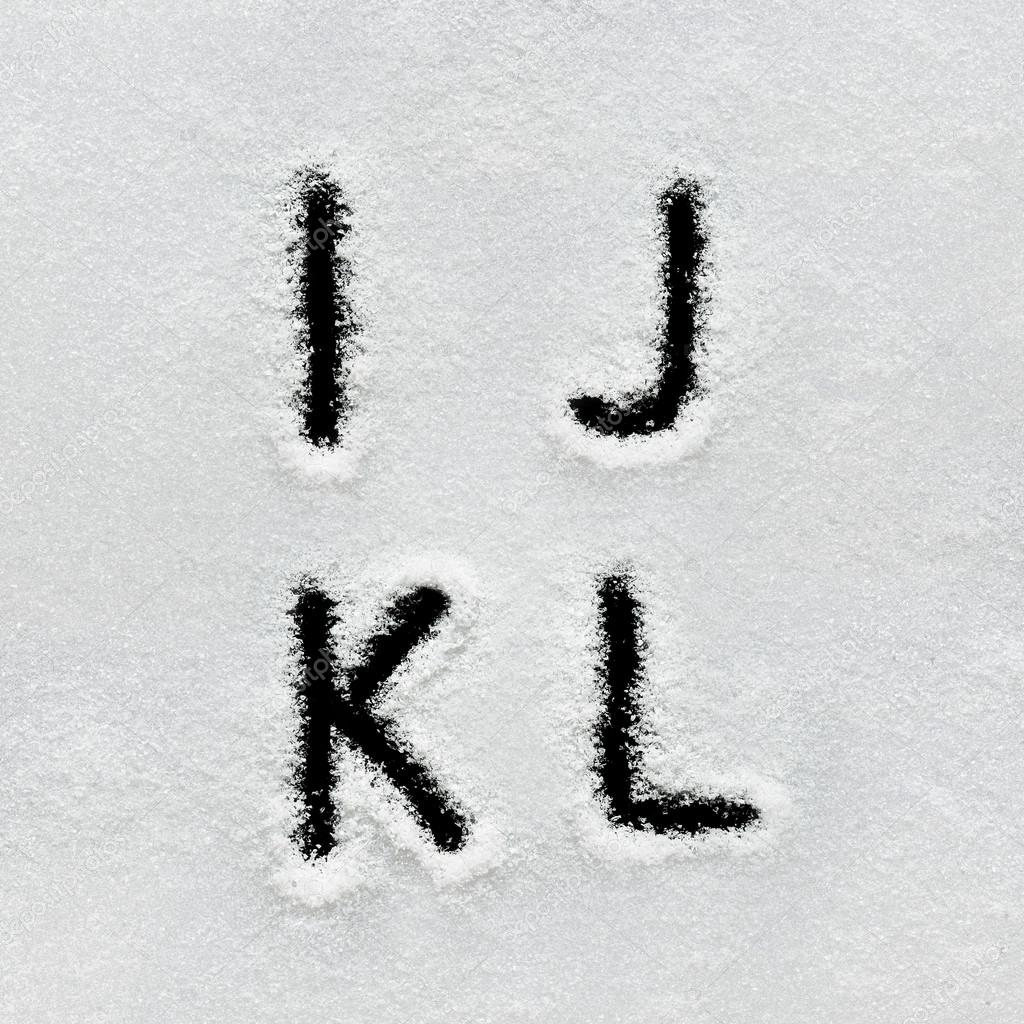 Winter alphabet, symbols and numbers hand written on snow.