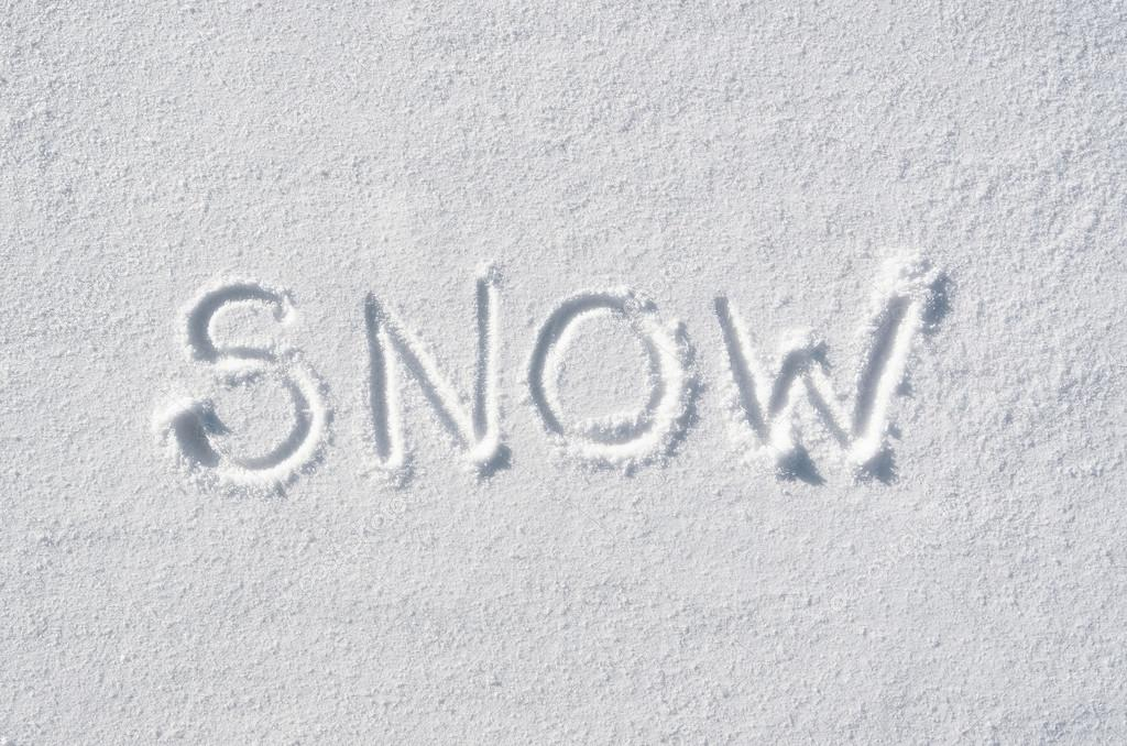 Text snow hand written on snow background. Horizontal winter.