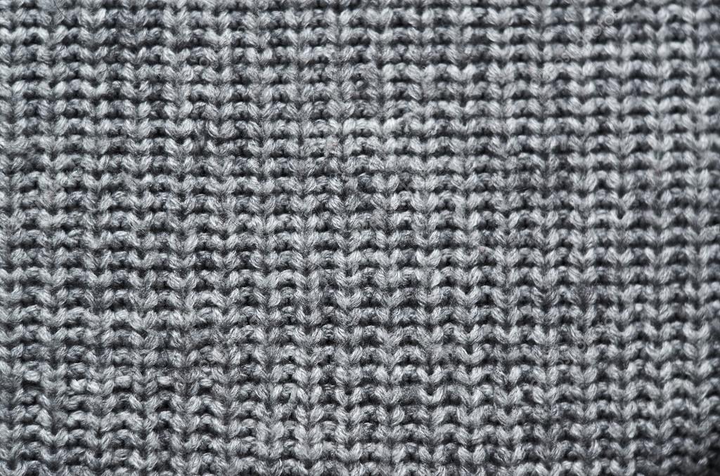 Grijze Gebreide Trui.Grijze Gebreide Trui Textuur Achtergrond Ruimte Voor Kopieren