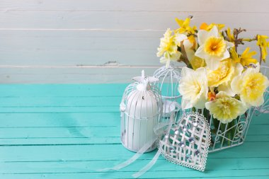 yellow daffodils flowers and decorative cage