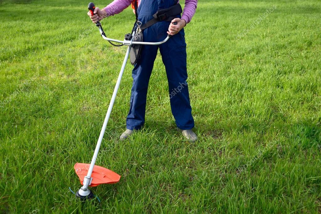 Man mows a grass