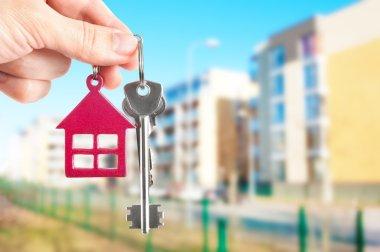 Handing keys in the house background