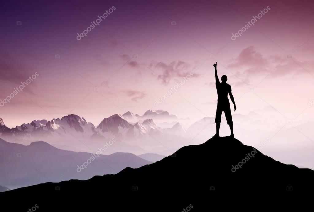 Winner silhouette on mountain top