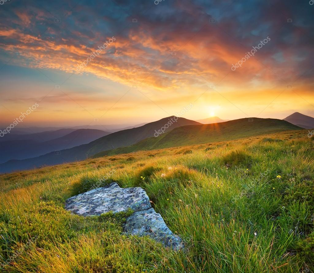 Bright sunset in mountain in summer time