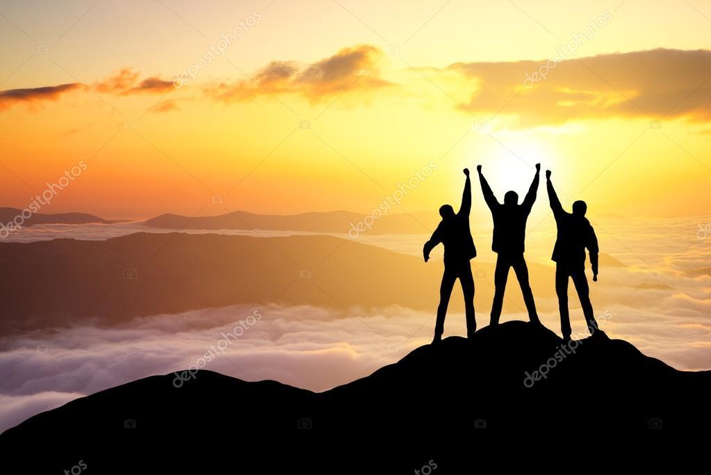 Silhouettes of tourist team on mountain