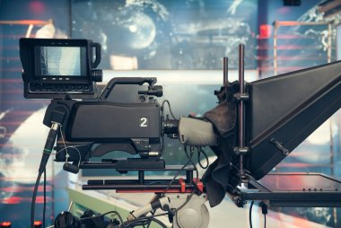Television studio with camera and lights - recording TV NEWS
