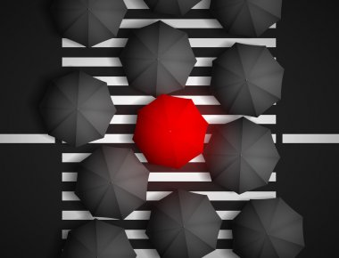 Red umbrella and black umbrellas on a background of a pedestrian