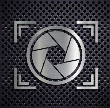 Flat metallic logo camera.