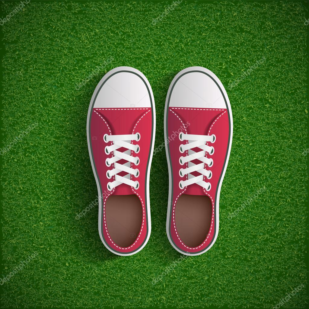Vintage sneakers standing on green grass.