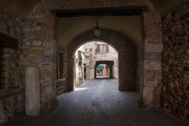 Stone arches in the ancient fortress on the banks of Lake Garda