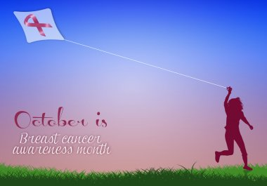 Woman with kite for breast cancer