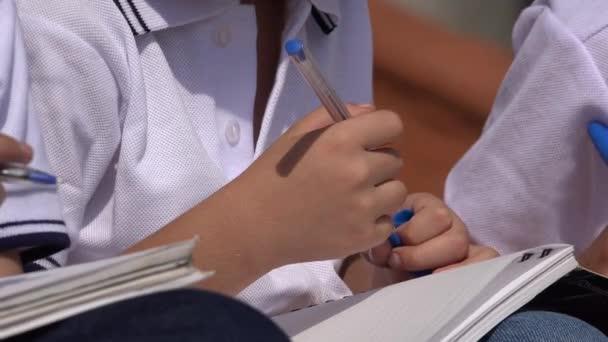 School Children With Notebooks