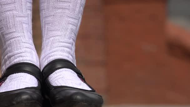Female Wearing Black Shoes And White Socks
