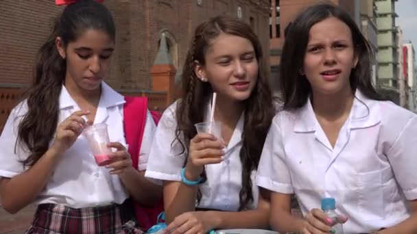 Young Girls Drinking Juice And Water