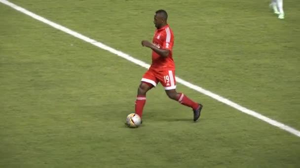 African Soccer Player Kicks Ball