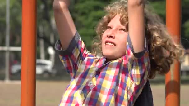 Boy Having Fun on Playground