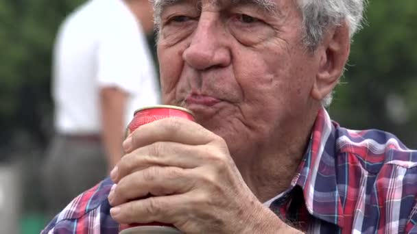Senior Drinking Refreshing Beer Or Soda