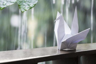 Origami paper crane on the balcony