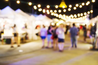 Abstract blurred background of people shopping at night market