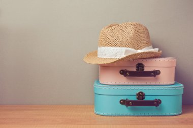 decorative suitcases and hat