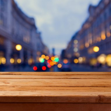 wooden table over city lights