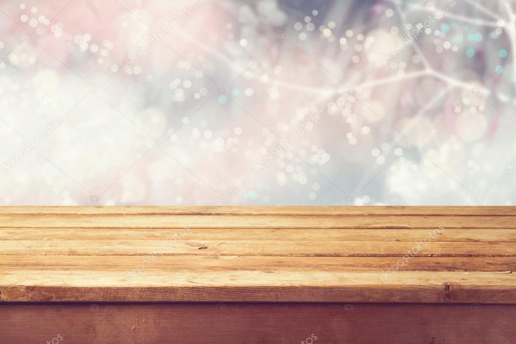 Winter bokeh background and wooden table