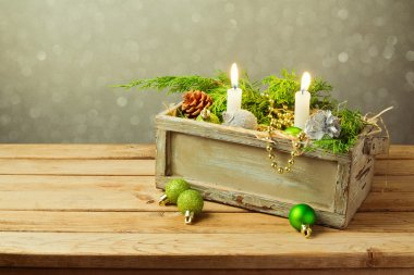Box with Christmas decorations and candles