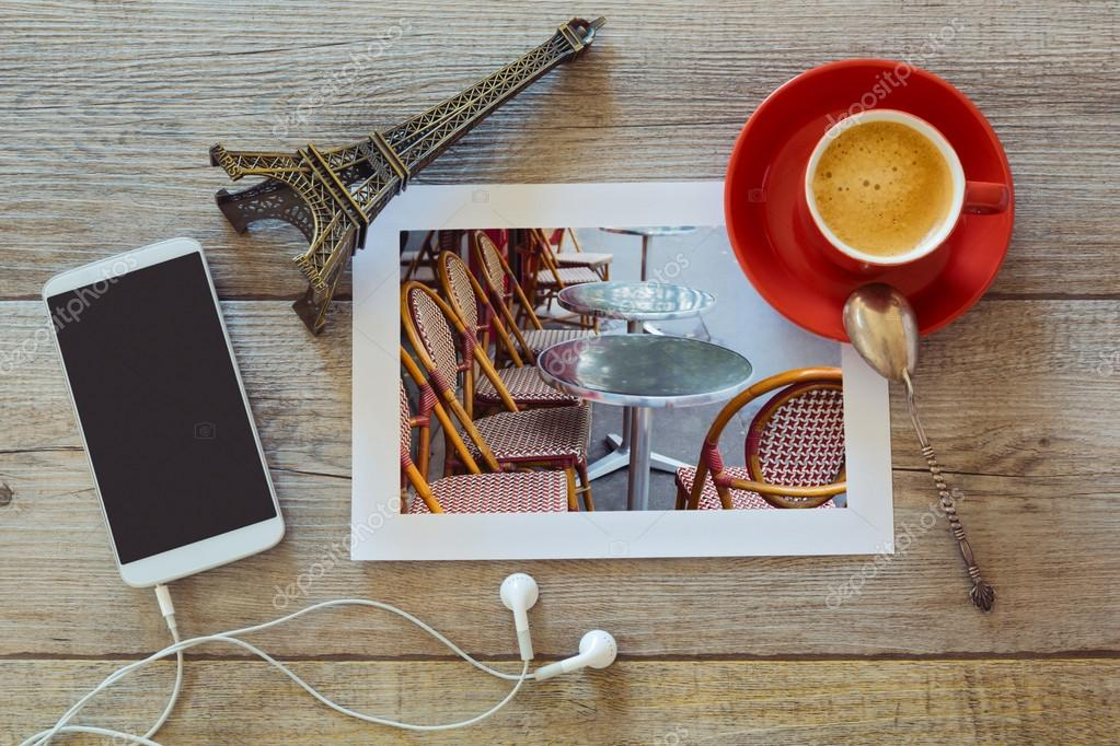 Coffee, smartphone and photo on table