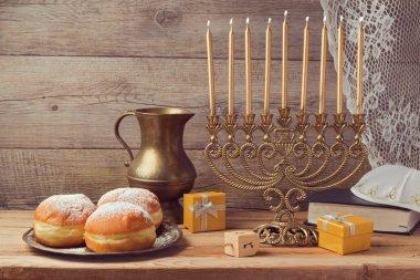 Hanukkah celebration with vintage menorah