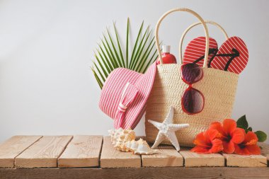 Summer beach bag and hibiscus flowers