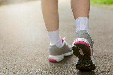 Young girl in running shoes