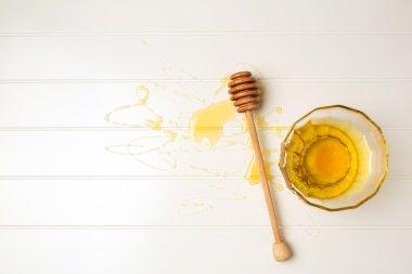 Honey on white table