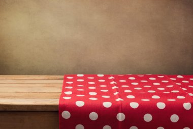 wooden table with polka dots tablecloth