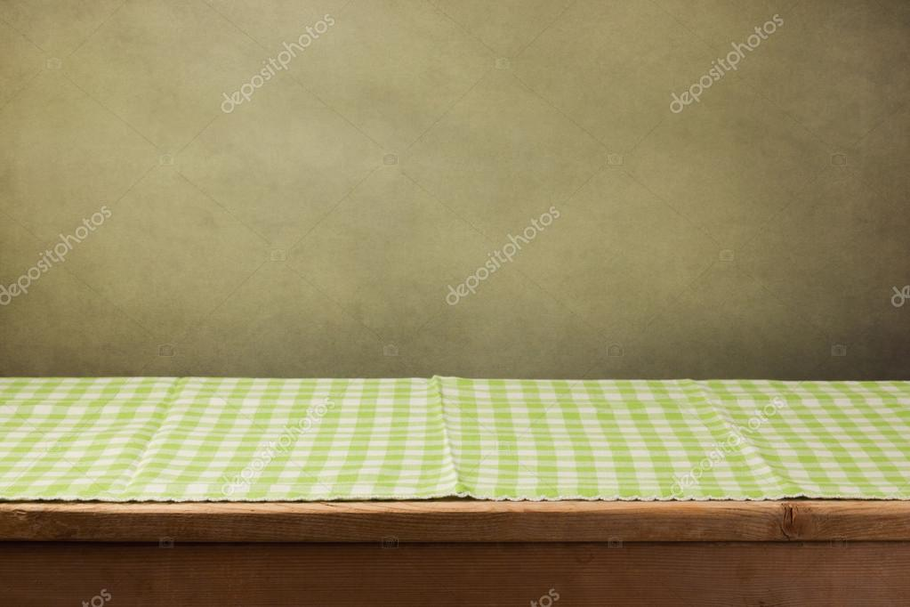 Wooden table with green tablecloth