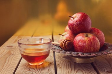 Apple and honey over golden background